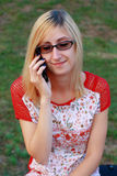 Cute Blonde Girl Talking On Phone Royalty Free Stock Photos