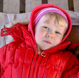 Cute blonde girl toddler in red jacket Stock Photo