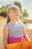 Cute blonde girl on vacation in park, close-up Royalty Free Stock Image