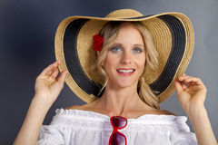 Cute Blonde Girl Wearing A Straw Summer Hat Stock Image