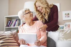 Cute blonde granddaughter with grandmother royalty free stock photos