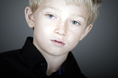 Cute Blonde Haired Boy Looking Pensive Royalty Free Stock Images