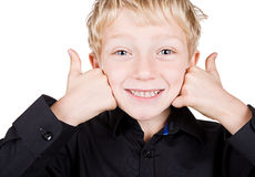 Cute Blonde Haired Boy Smiling with Thumbs Up Royalty Free Stock Photography