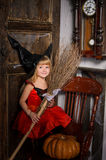 cute blonde halloween witch girl with broom Royalty Free Stock Photo