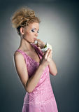 Cute blonde happy woman eat cake Stock Photography