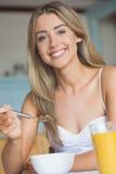 Cute blonde having her breakfast Royalty Free Stock Images