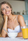 Cute blonde having her breakfast Stock Photos