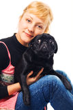 Cute blonde hugging a pug. Isolated on white Royalty Free Stock Images