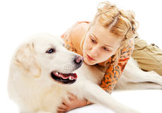 Cute blonde hugging a retriever. Isolated on white Stock Photo