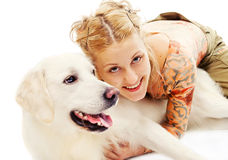 Cute blonde hugging a retriever. Isolated on white Stock Images