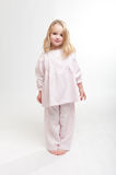 Cute blonde kid in her pajamas Stock Images