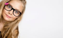 Cute blonde little girl in glasses on a white background in the