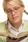 Cute Blonde Plays With Ponytails & Reads a Book Stock Photos