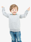 Cute blonde small boy dressed in a gray sweater Stock Photo