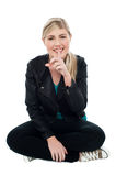 Cute blonde teen gesturing silence Royalty Free Stock Photography