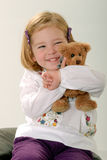 Cute blonde toddler with teddy Royalty Free Stock Photo