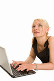 Cute blonde typing on her laptop. Cute blond typing on her laptop Royalty Free Stock Images