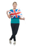 Cute blonde UK supporter striking stylish pose Royalty Free Stock Photo