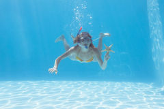 Cute blonde underwater in the swimming pool with snorkel and starfish Stock Photography