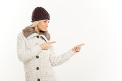 Cute Blonde In Winter Clothes Pointing Away Stock Photo
