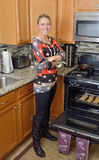 Cute Blonde Woman In Kitchen