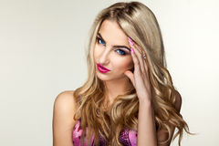 Cute blonde woman in pink bra Royalty Free Stock Photography