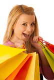 Cute blonde woman with shopping vibrant bags isolated over white Royalty Free Stock Image