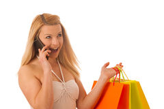 Cute blonde woman with shopping vibrant bags isolated over white Stock Photography