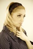 Cute blonde woman thinking filtered Royalty Free Stock Image