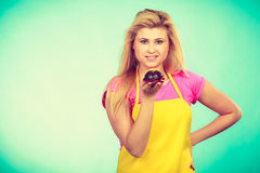 Cute blonde woman about to eat cupcake Royalty Free Stock Images