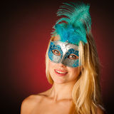 Cute blonde woman with venice mask on her face glamorous portrai Stock Photo