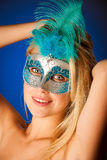 Cute blonde woman with venice mask on her face glamorous portrai Royalty Free Stock Images