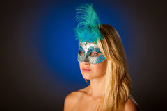 Cute blonde woman with venice mask on her face glamorous portrai Stock Images
