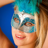 Cute blonde woman with venice mask on her face glamorous portrai Royalty Free Stock Photo
