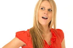 Cute blonde woman wearing red shirt with mouth open Stock Photo