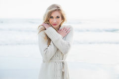 Cute blonde woman in wool cardigan warming up Stock Images