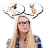 Cute blondie girl dreaming about dog isolated on white Stock Image