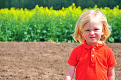 Cute blondy baby. In field Royalty Free Stock Image