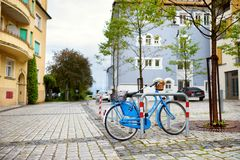 Blue bicycle parked on the street of Lindau, Germany. Cute blue bicycle parked on the street of Lindau, Germany Royalty Free Stock Photo