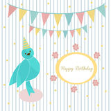 Cute blue bird on a background of festive garland and frame with inscription happy birthday. Cute blue bird on a background of festive garland and frame with Stock Photo