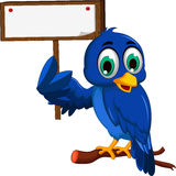 Cute blue bird cartoon holding blank board Royalty Free Stock Image