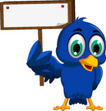 Cute blue bird cartoon holding blank board Stock Photo