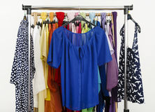 Cute blue blouses displayed on a rack. Stock Images