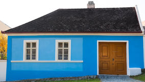 Cute blue colored traditional house Stock Image