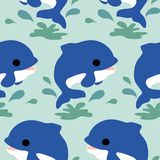 Cute blue dolphines in a seamless pattern design