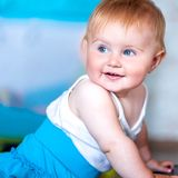 Cute blue-eyed baby. Face of cute blue-eyed baby close up royalty free stock photo