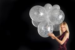 Cute blue-eyed blonde with wonderful balloons Royalty Free Stock Image