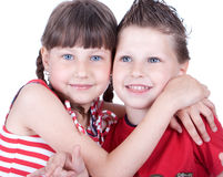 Cute blue-eyed boy and girl hugging each other Royalty Free Stock Photography