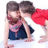 Cute blue-eyed boy and girl are playing Royalty Free Stock Photo