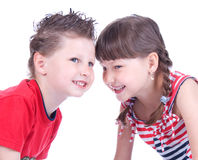 Cute blue-eyed boy and girl are playing Royalty Free Stock Photos